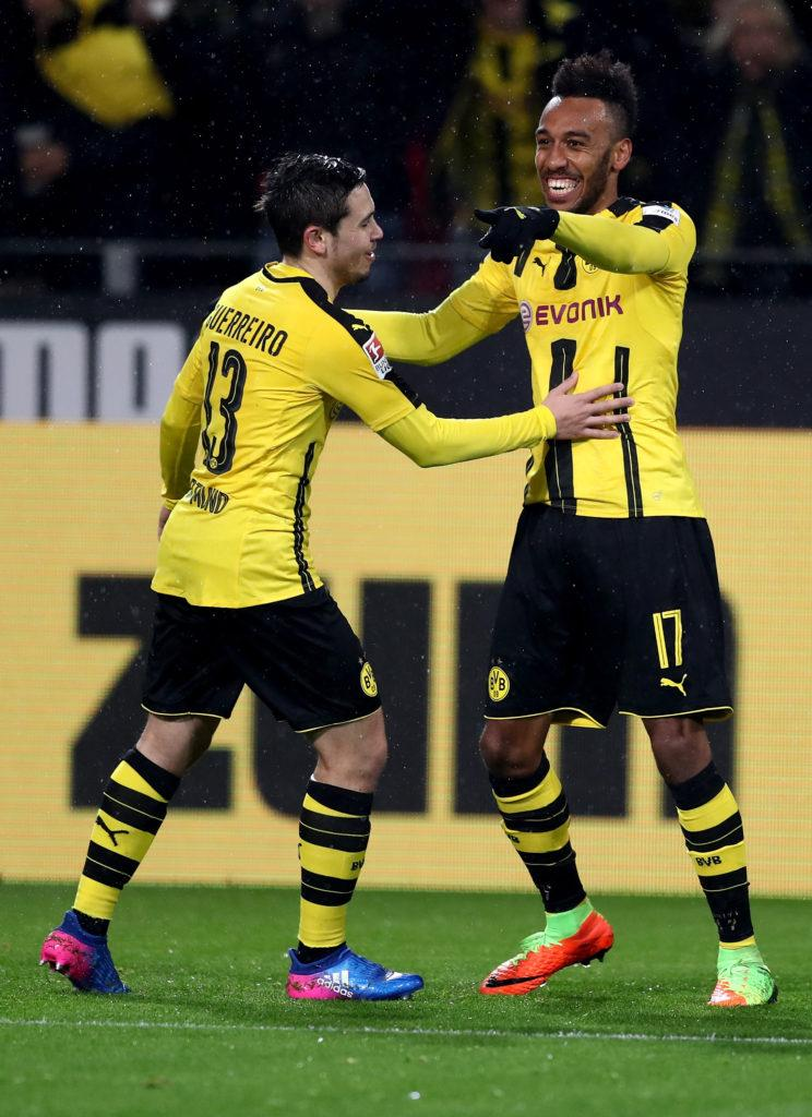 DORTMUND, GERMANY - FEBRUARY 04: Pierre Emerick Aubameyang (R) of Dortmund celebrate with team mate Raphael Guerreiro after he scores the opening goal during the Bundesliga match between Borussia Dortmund and RB Leipzig at Signal Iduna Park on February 4, 2017 in Dortmund, Germany. (Photo by Lars Baron/Bongarts/Getty Images)