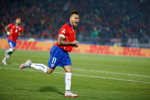 Chile's Eduardo Vargas, right, celebrates after scoring against Peru during a Copa America semifinal soccer match at the National Stadium in Santiago, Chile, Monday, June 29, 2015. (AP Photo/Andre Penner)