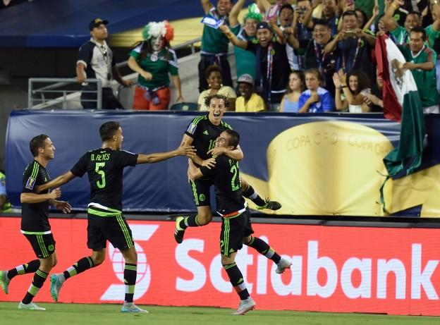 Mexico's Andres Guardado (C) celebrates his goal during the 2015 CONCACAF Gold Cup final between Jamaica and Mexico in Philadelphia on July 26, 2015. AFP PHOTO/DON EMMERT        (Photo credit should read DON EMMERT/AFP/Getty Images)