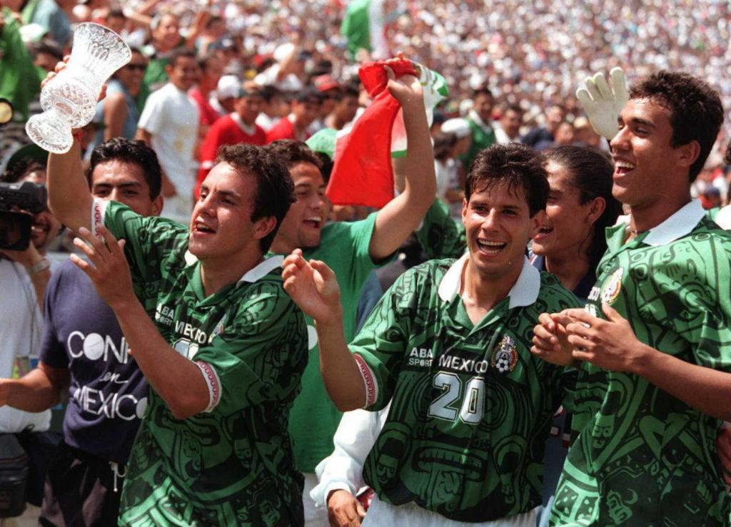 PASADENA, : Cuauhtemoc Blanco (L) and others from Mexico's national soccer team celebrate with the trophy after winning the US Cup '96 tournament 16 June in Pasadena, California. Blanco scored the second goal against the United States for a 2-2 score, giving Mexico the tiebreaker. AFP PHOTO/Vince BUCCI (Photo credit should read Vince Bucci/AFP/Getty Images)
