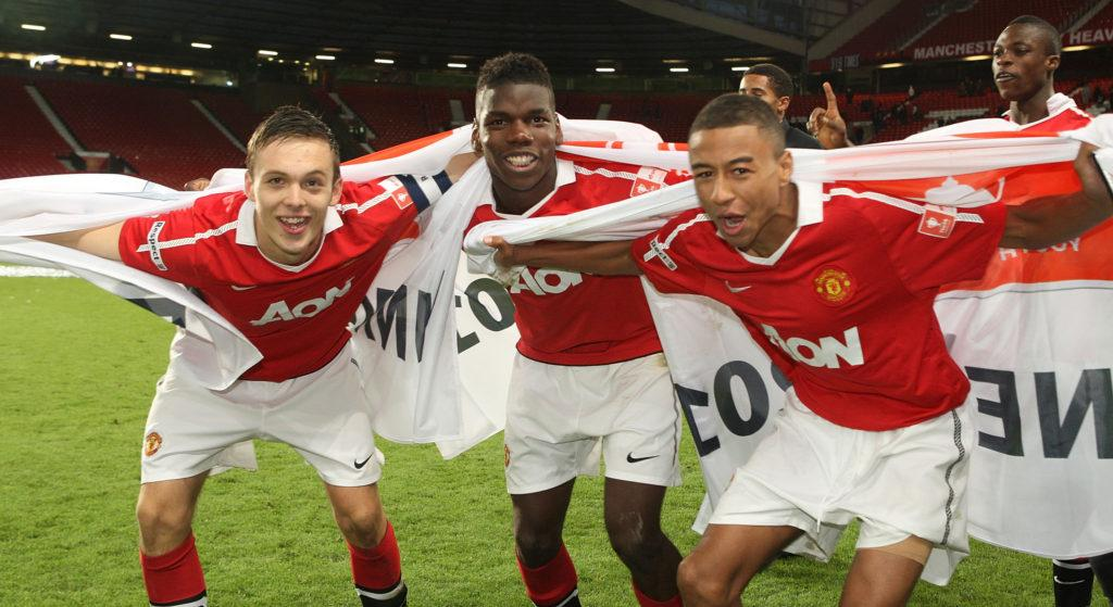 MANCHESTER, ENGLAND - MAY 23: (L-R) Tom Thorpe, Paul Pogba and Jesse Lingard of Manchester United Academy Under-18s celebrate with the FA Youth Cup trophy after the FA Youth Cup Final Second Leg match between Manchester United Academy Under-18s and Sheffield United Academy Under-18s at Old Trafford on May 23, 2011 in Manchester, England. (Photo by John Peters/Man Utd via Getty Images)