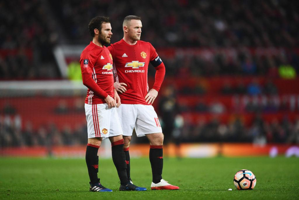 MANCHESTER, ENGLAND - JANUARY 29: Wayne Rooney and Juan Mata of Manchester United line up a free kick during the Emirates FA Cup Fourth round match between Manchester United and Wigan Athletic at Old Trafford on January 29, 2017 in Manchester, England. (Photo by Laurence Griffiths/Getty Images)