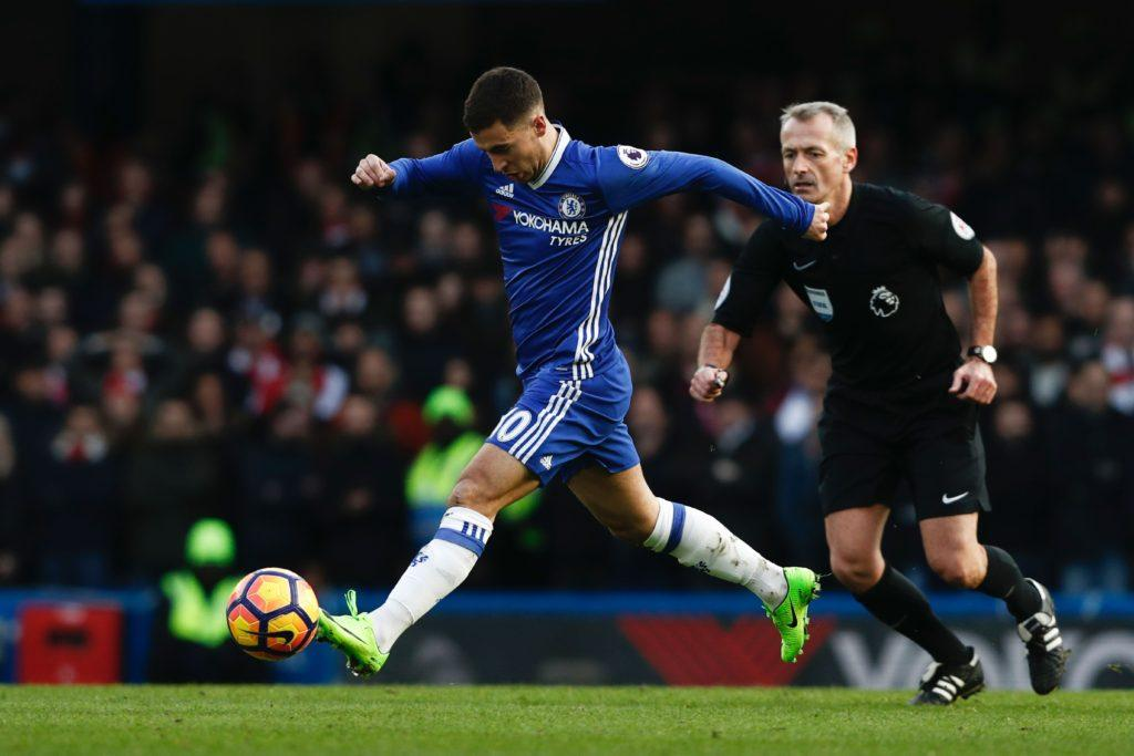 Chelsea's Belgian midfielder Eden Hazard runs with the ball plays during the English Premier League football match between Chelsea and Arsenal at Stamford Bridge in London on February 4, 2017. / AFP / Adrian DENNIS / RESTRICTED TO EDITORIAL USE. No use with unauthorized audio, video, data, fixture lists, club/league logos or 'live' services. Online in-match use limited to 75 images, no video emulation. No use in betting, games or single club/league/player publications. / (Photo credit should read ADRIAN DENNIS/AFP/Getty Images)