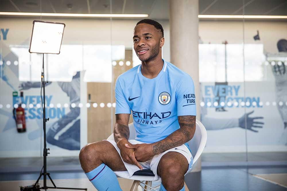 2017-18 Nike Manchester City home jersey with Raheem Sterling.