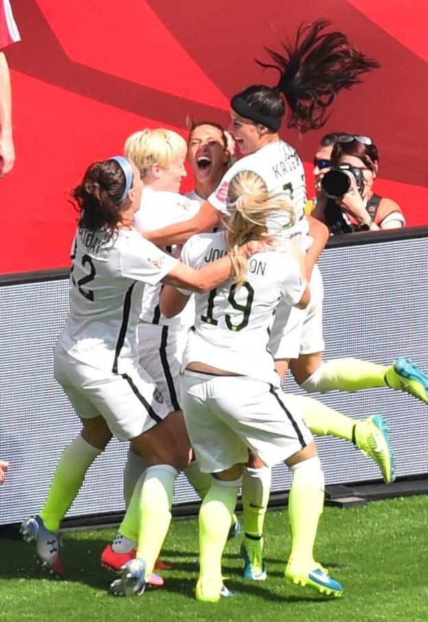 USA players celebrate a goal by the USA's Carli Lloyd (C) during the  2015 FIFA Women's World Cup final between the USA and Japan at BC Place Stadium in Vancouver, British Columbia on July 5, 2015.   AFP PHOTO/NICHOLAS KAMM        (Photo credit should read NICHOLAS KAMM/AFP/Getty Images)