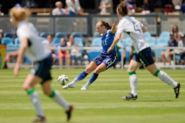 SAN JOSE, CA - MAY 10:  Lauren Holiday #12 of the United States chips the ball against Ireland in the first half of their international friendly match on May 10, 2015 at Avaya Stadium in San Jose, California.  The U.S. won 3-0.  (Photo by Brian Bahr/Getty Images)