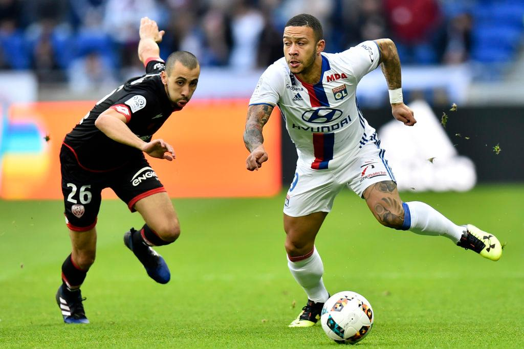 Lyon's Dutch forward Memphis Depay (R) outruns Dijon's French defender Fouad Chafik during the French L1 football match between Olympique Lyonnais (OL) and Dijon (DFCO) on February 19, 2017, at the Parc Olympique Lyonnais stadium in Decines-Charpieu near Lyon, central-eastern France. / AFP / ROMAIN LAFABREGUE (Photo credit should read ROMAIN LAFABREGUE/AFP/Getty Images)