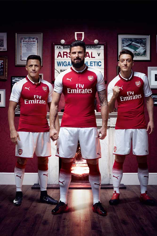 Alexis Sanchez, Olivier Giroud and Mesut Ozil in the 2017-18 PUMA Arsenal home jersey