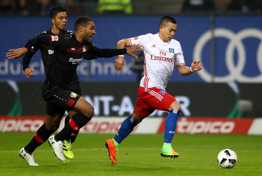 HAMBURG, GERMANY - FEBRUARY 03: Bobby Wood (R) of Hamburg and Jonathan Tah of Leverkusen battle for the ball during the Bundesliga match between Hamburger SV and Bayer 04 Leverkusen at Volksparkstadion on February 3, 2017 in Hamburg, Germany. (Photo by Martin Rose/Bongarts/Getty Images)