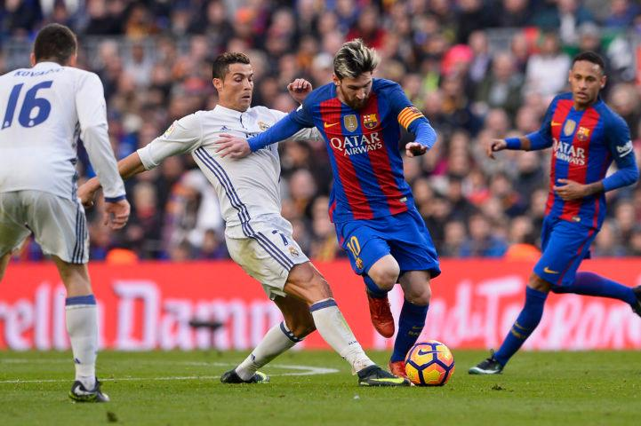 Barcelona's Argentinian forward Lionel Messi (2ndR) vies with Real Madrid's Portuguese forward Cristiano Ronaldo during the Spanish league football match FC Barcelona vs Real Madrid CF at the Camp Nou stadium in Barcelona on December 3, 2016. / AFP / JOSEP LAGO (Photo credit should read JOSEP LAGO/AFP/Getty Images)
