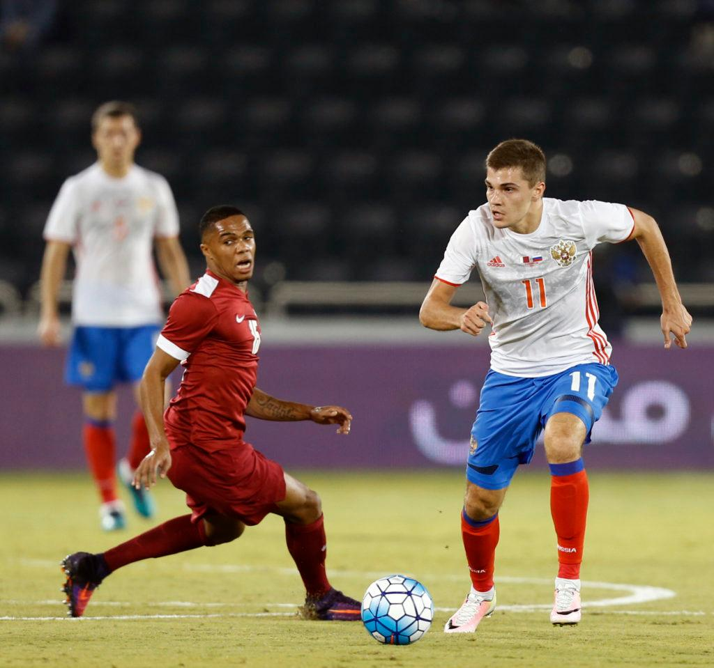 Russia's midfielder Roman Zobnin (R) dribbles past Qatar's defender Pedro Miguel Correia (L) during the International friendly match between Qatar and Russia at the Jassim Bin Hamad Stadium in Doha on November 10, 2016. / AFP / STRINGER (Photo credit should read STRINGER/AFP/Getty Images)