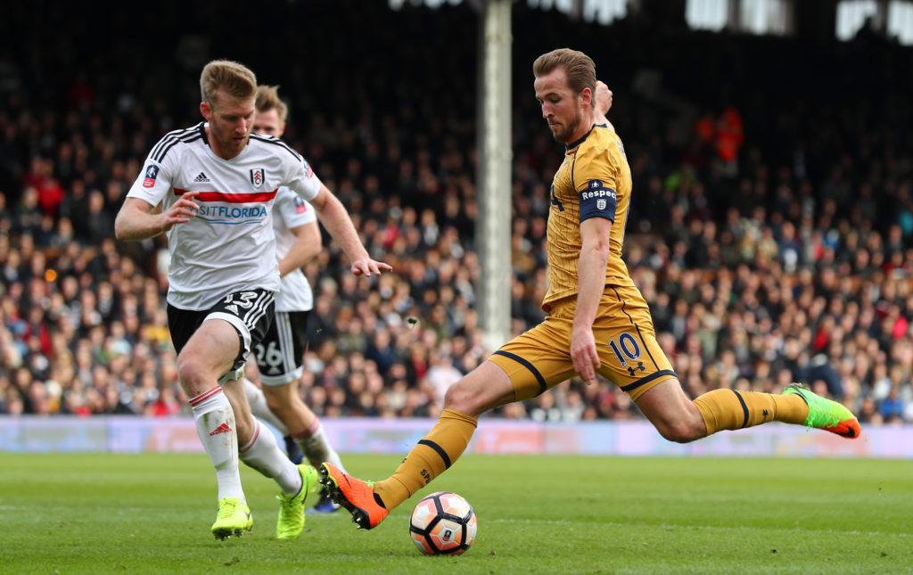 LONDON, ENGLAND - FEBRUARY 19: Harry Kane of Tottenham Hotspur shoots past Tim Ream of Fulham during The Emirates FA Cup Fifth Round match between Fulham and Tottenham Hotspur at Craven Cottage on February 19, 2017 in London, England. (Photo by Clive Rose/Getty Images)