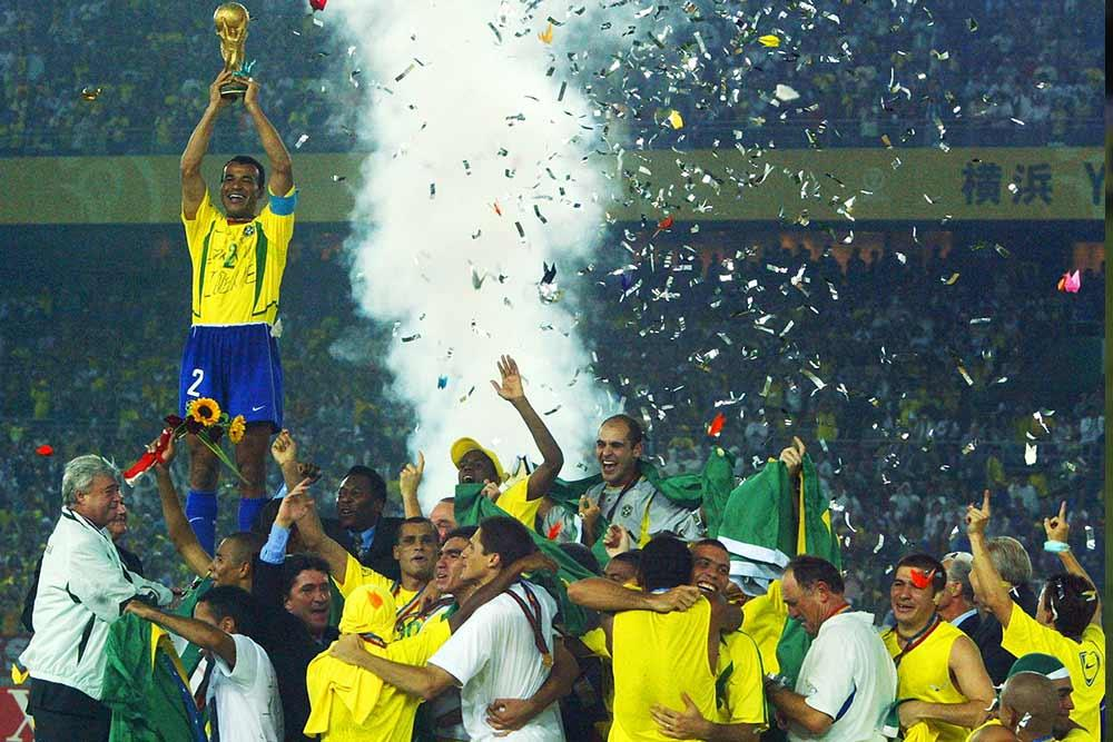 Brazil captain Cafu lifts the 2002 FIFA World Cup trophy.
