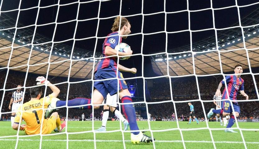 Barcelona's Croatian midfielder Ivan Rakitic celebrates with the ball (c) after his teammate Luis Suarez (unpictured) scored the 1-2 during the UEFA Champions League Final football match between Juventus and FC Barcelona at the Olympic Stadium in Berlin on June 6, 2015.  AFP PHOTO / PATRIK STOLLARZ        (Photo credit should read PATRIK STOLLARZ/AFP/Getty Images)