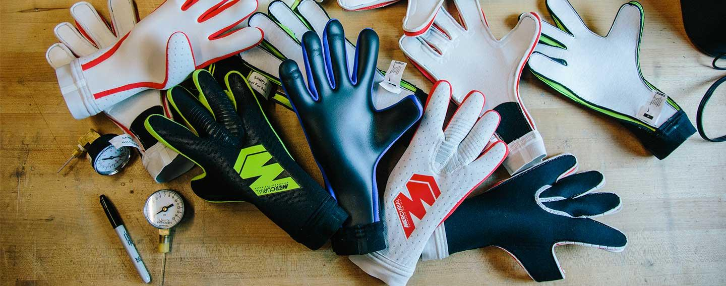 Nike Mercurial Touch Gloves scattered on table