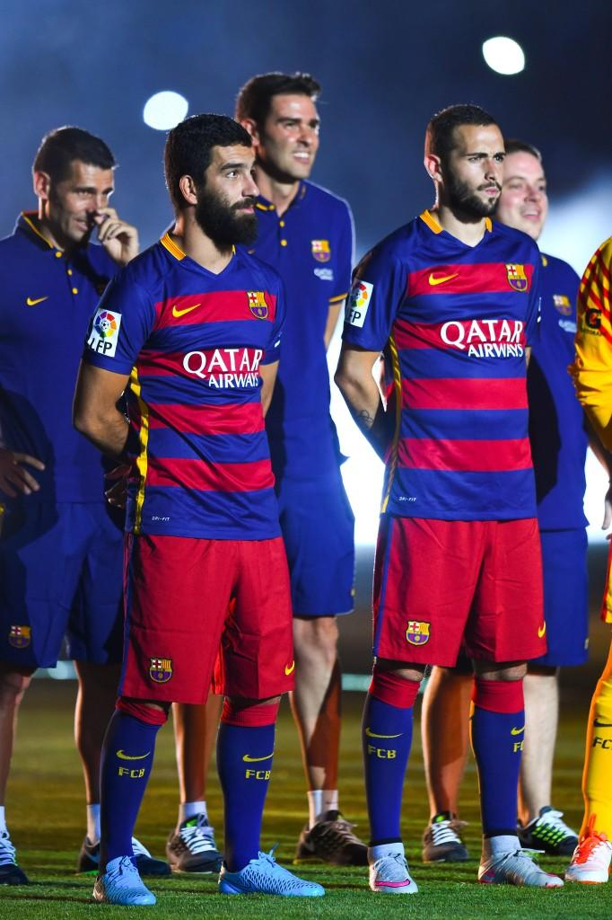 BARCELONA, SPAIN - AUGUST 05:  Arda Turan (L) and Aleix Vidal of FC Barcelona look on during the team official presentation ahead of the Joan Gamper trophy match at Camp Nou on August 5, 2015 in Barcelona, Spain.  (Photo by David Ramos/Getty Images)