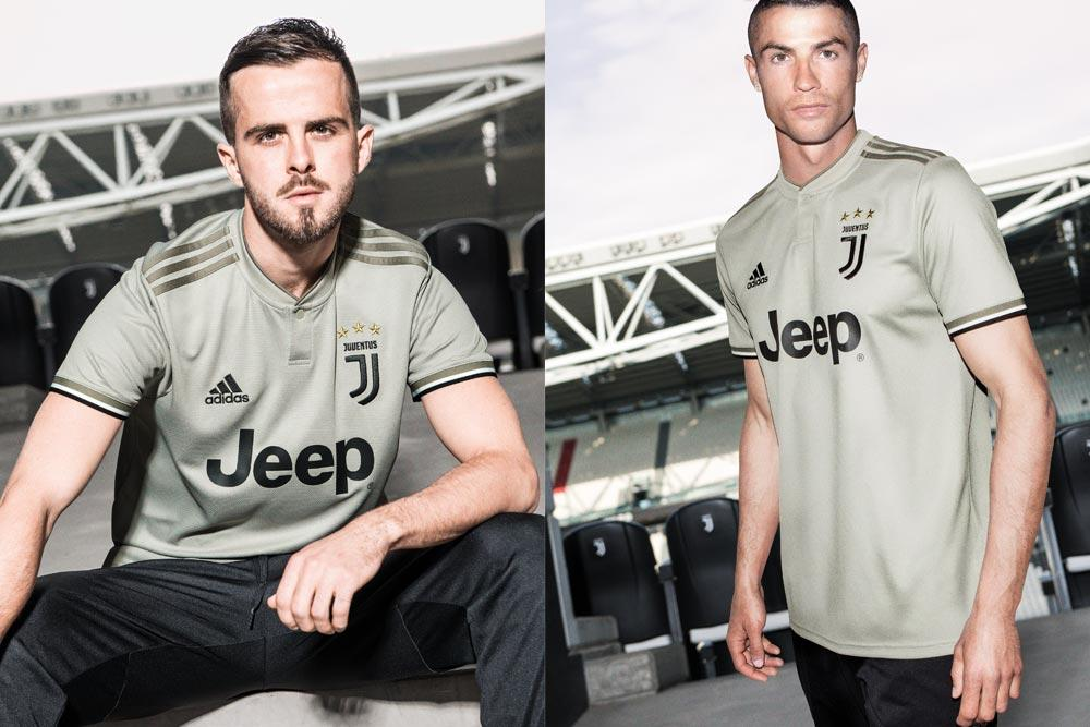 Miralem Pjanic and Cristiano Ronaldo in the 2018-19 adidas Juventus away jersey