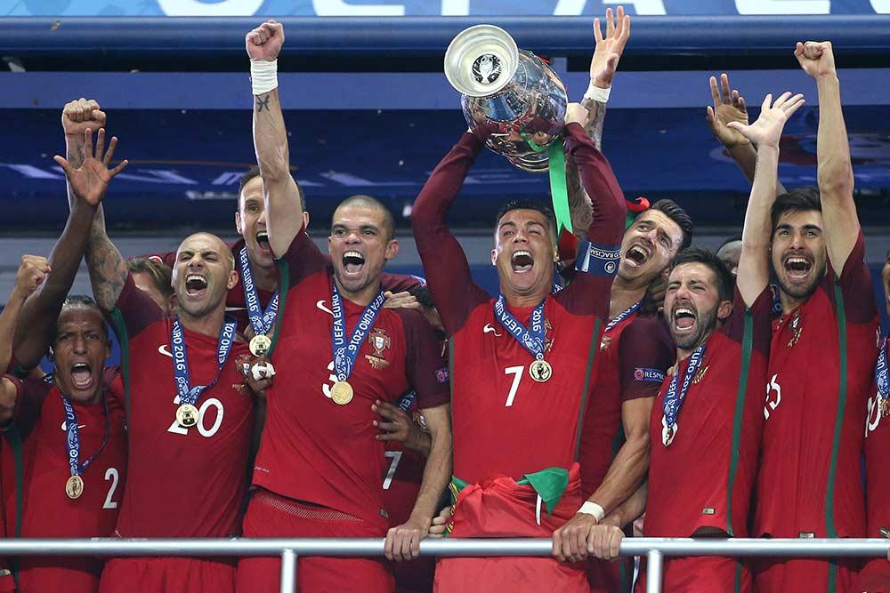 Cristiano Ronaldo lifts the 2016 UEFA Euro France trophy with Portugal.