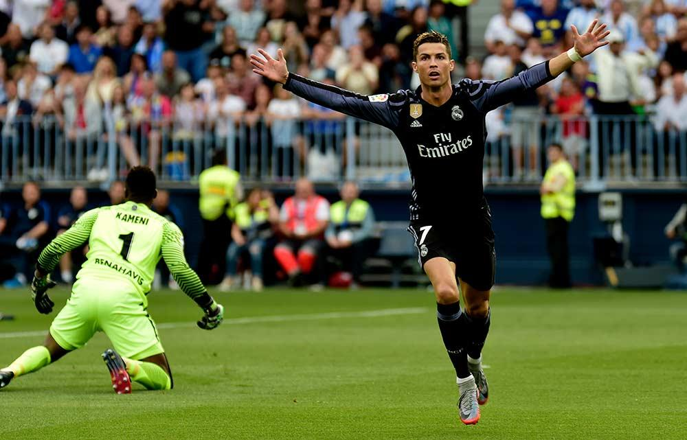 Cristiano Ronaldo celebrates his La Liga title-winning goal against Malaga.